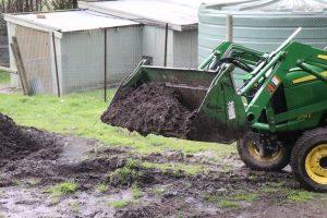 Green Team loader digging